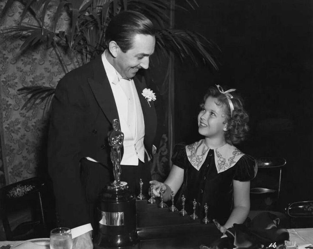 Walt Disney with his special Academy Awards and Shirley Temple.