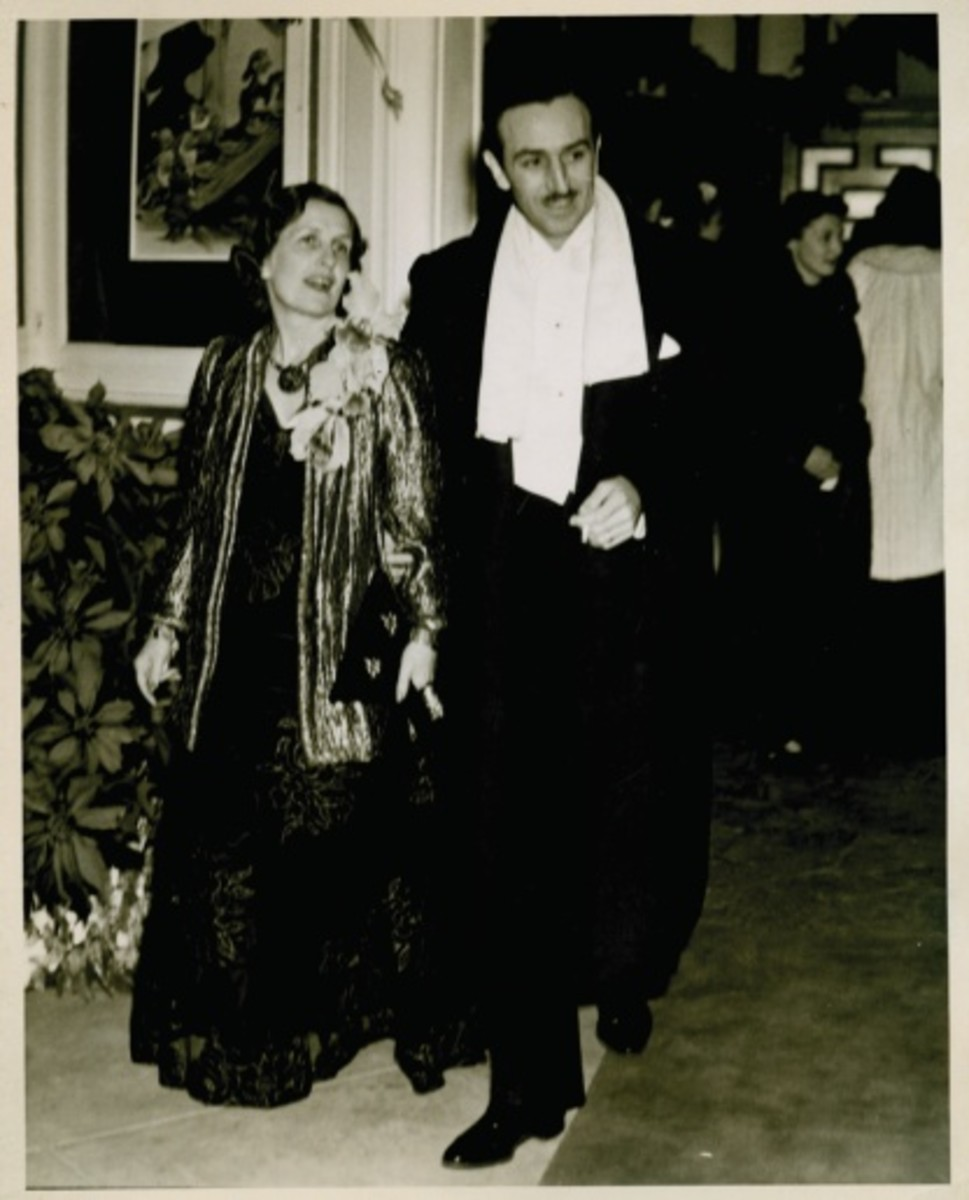 Walt Disney and his wife Lillian arriving at the premiere.