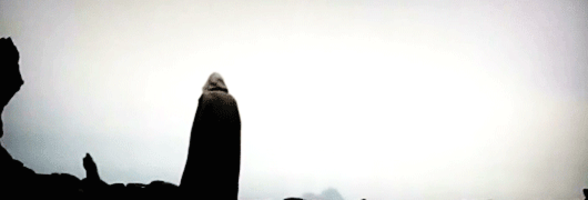 Luke standing over a mysterious headstone. Who is he mourning?