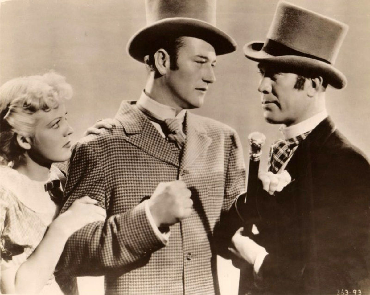 "Wayne in one of his early films, the 1936 ""Conflict"" costarring Ward Bond and Jean Rogers."