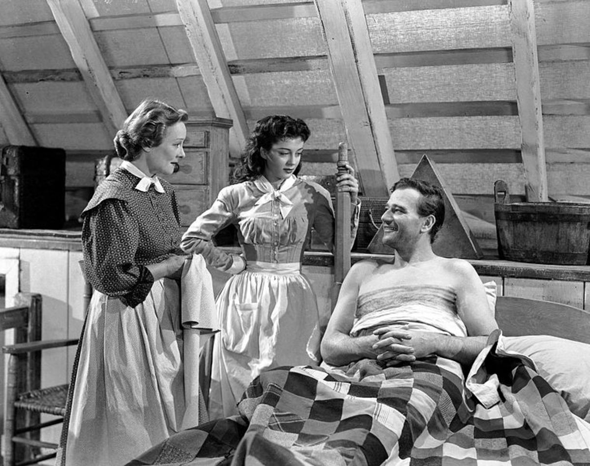 "John Wayne, Gail Russell and Irene Rich in a trailer screenshot from ""Angel and the Badman."" Public domain."