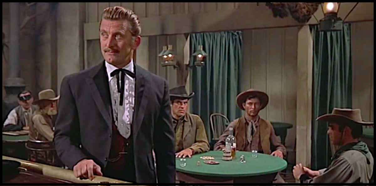 "In this scene from 1957's western classic ""Gunfight at the O.K. Corral"" Kirk Douglas is about to kill bad guy Lee Van Cleef, seated at the table behind him.."