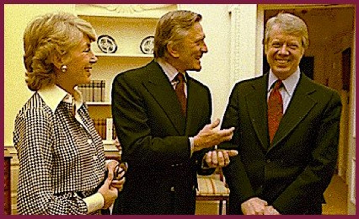 A long-time liberal Democrat, Kirk Douglas and wife Anne are shown here meeting President Jimmy Carter in the White House.