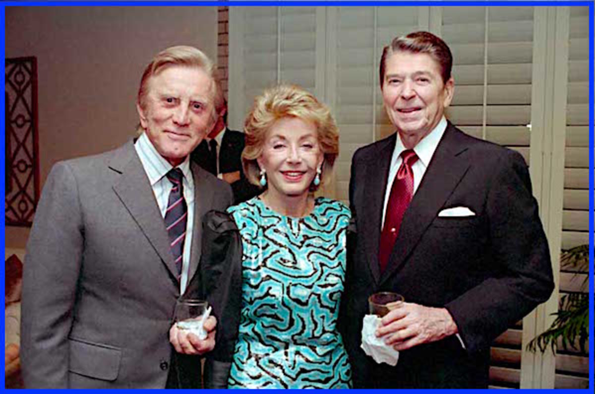 Kirk Douglas, wife Anne, and then-U.S. President Ronald Reagan at a 1987 private dinner in Palm Springs, California.  Although an avowed liberal Democrat, Douglas remained good friends with fellow actor and conservative icon Ronald Reagan.