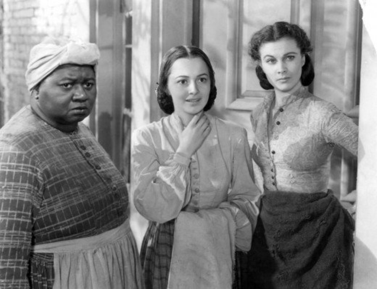 Hattie McDaniel (Mammy), Olivia de Havilland (Melanie) and Vivien Leigh (Scarlett) in Gone with the Wind.