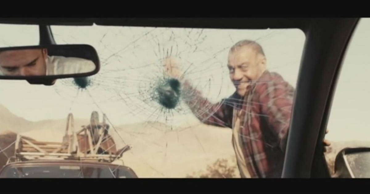 That angry man is smashing in the windshield.  Ha ha!
