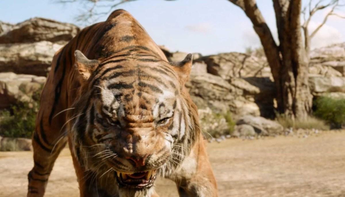 The villainous Shere Khan stalks Mowgli.