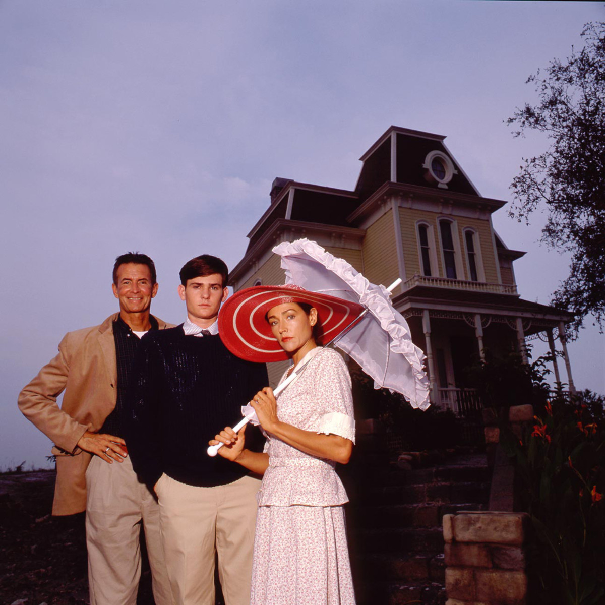 Anthony Perkins, Olivia Hussey and Henry Thomas on the Universal backlot where the film was made