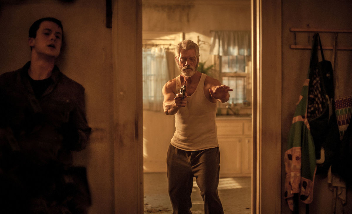 "Dylan Minnette and Stephen Lang in ""Don't Breathe."""