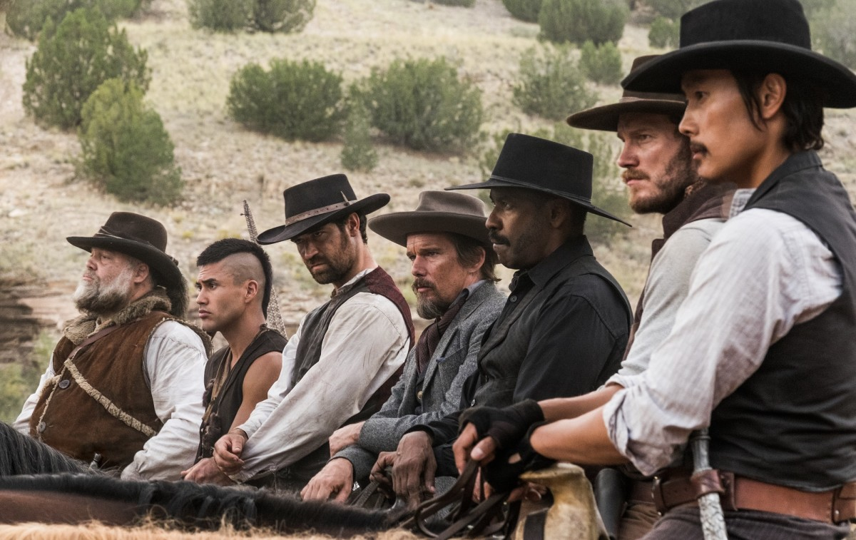 "Vincent D'Onofrio, Martin Sensmeier, Manuel Garcia-Rulfo, Ethan Hawke, Denzel Washington, Chris Pratt, and Lee Byung-hun in ""The Magnificent Seven."""