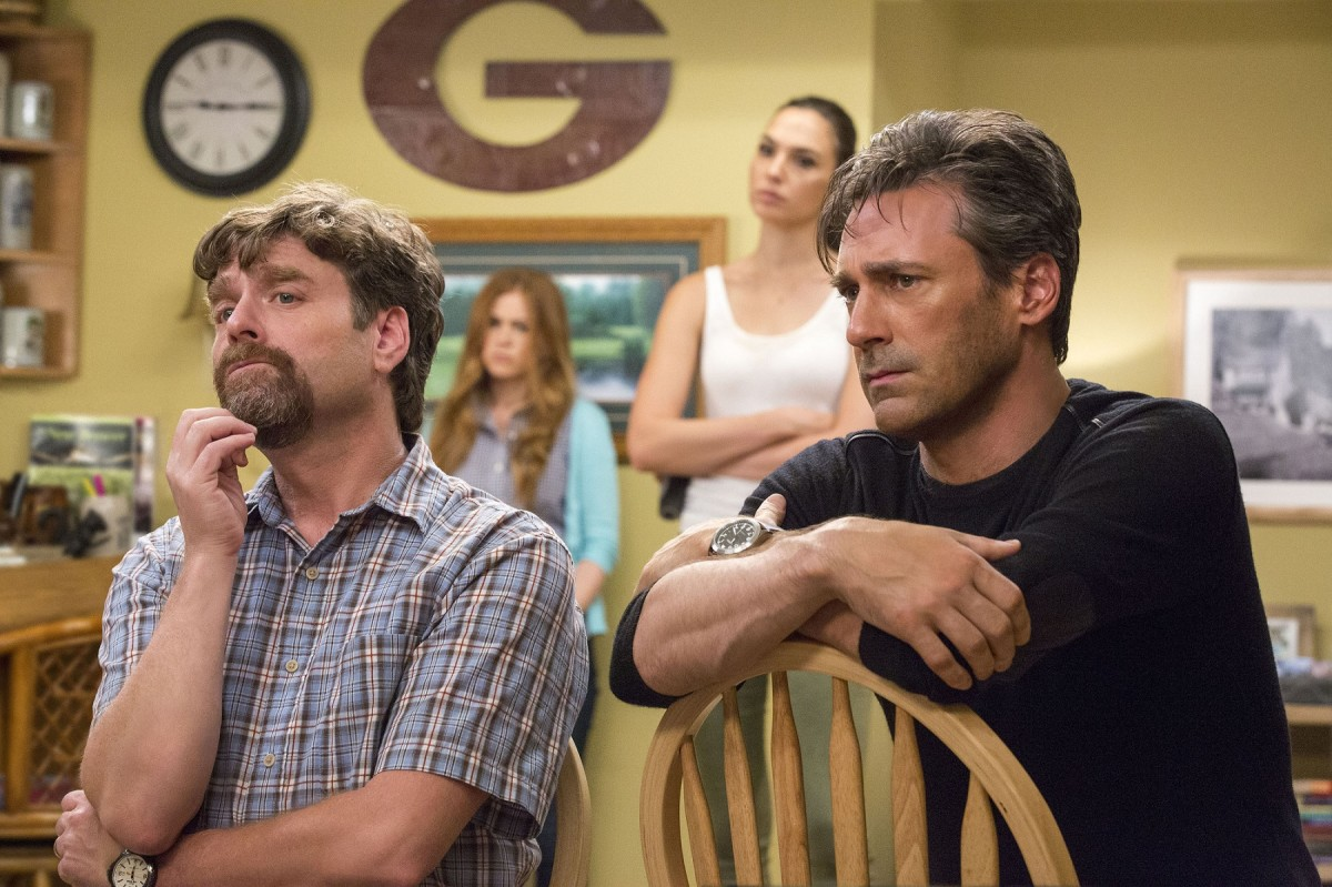 "Zach Galifianakis, Isla Fisher, Gal Gadot, and Jon Hamm in ""Keeping Up with the Joneses."""