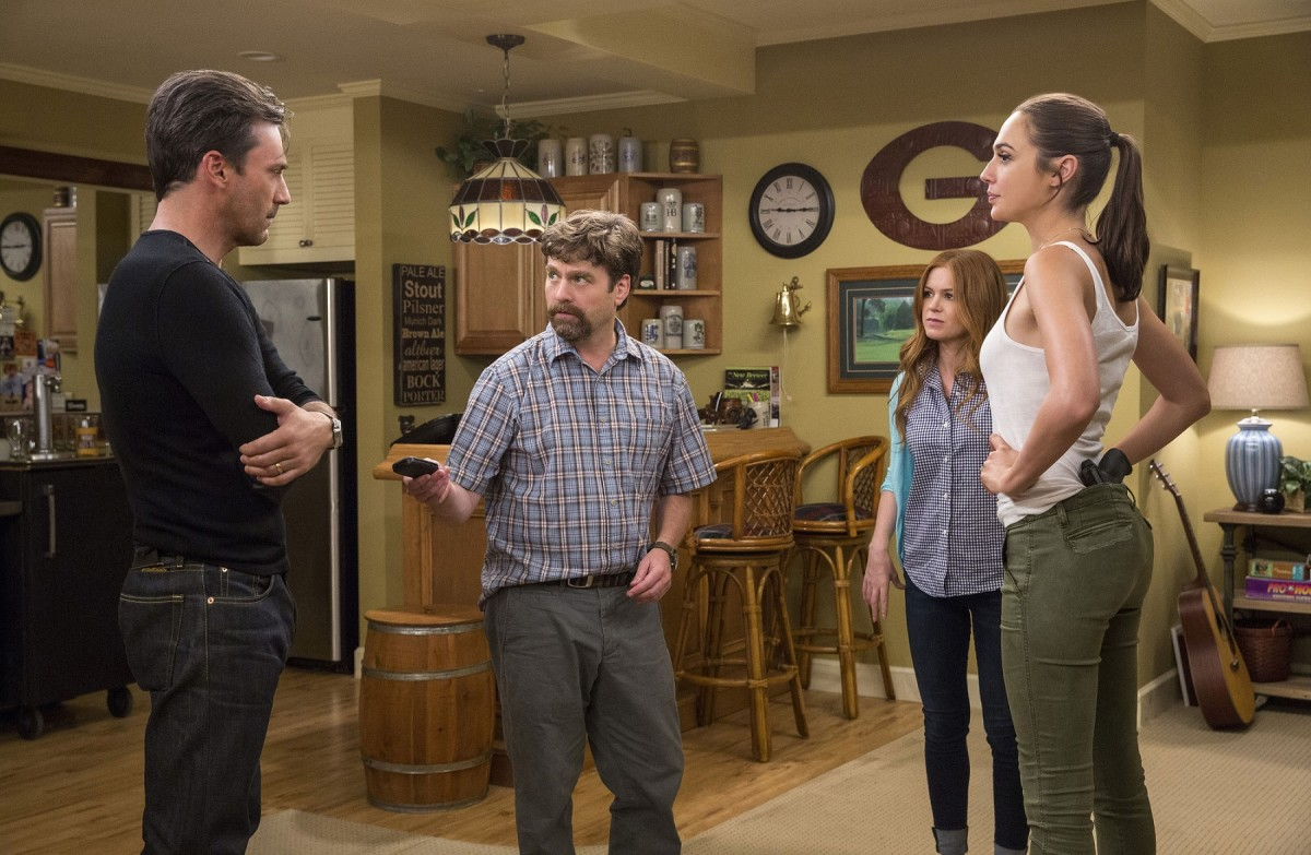 "Jon Hamm, Zach Galifianakis, Isla Fisher, and Gal Gadot in ""Keeping Up with the Joneses."""