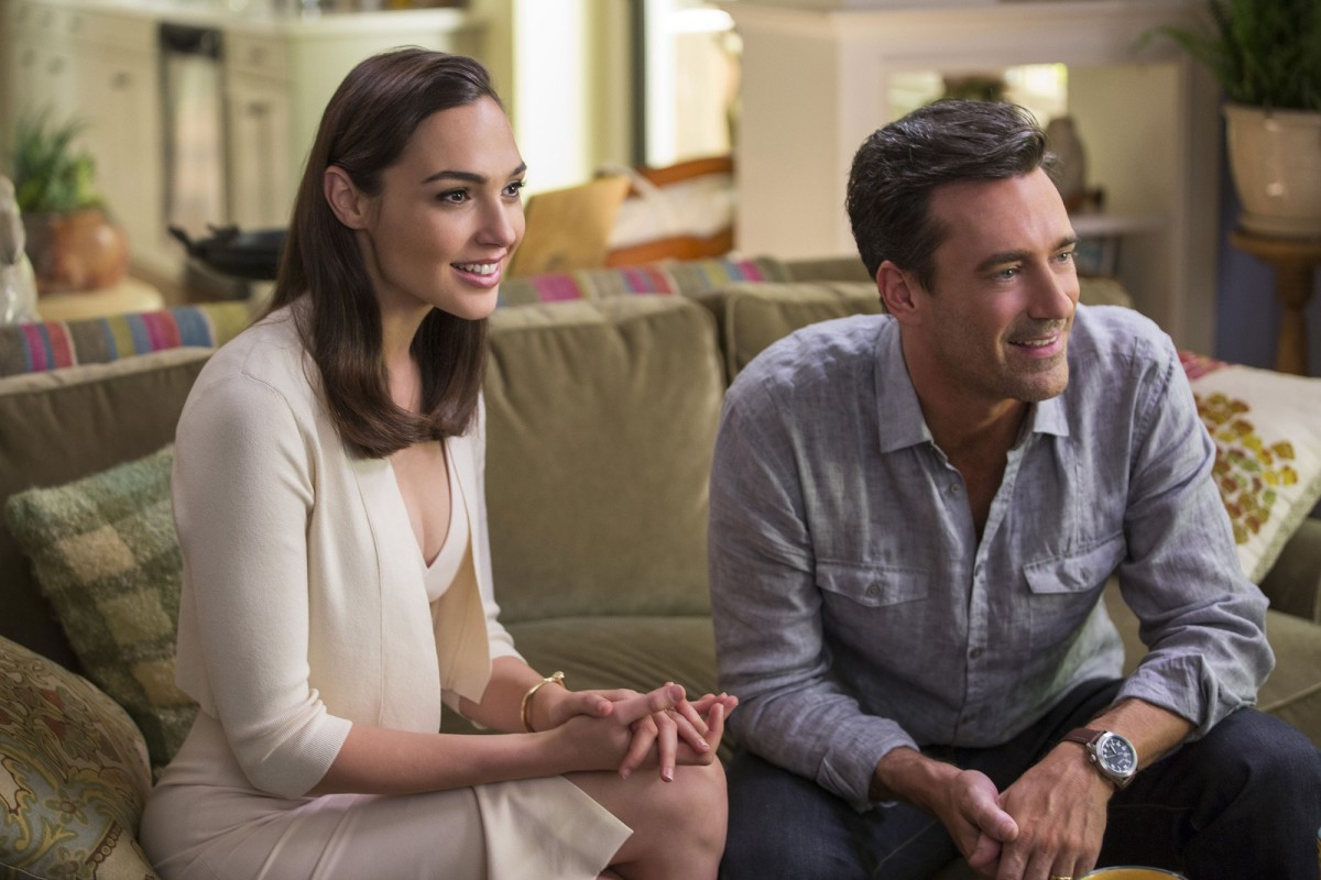 "Gal Gadot and Jon Hamm in ""Keeping Up with the Joneses."""