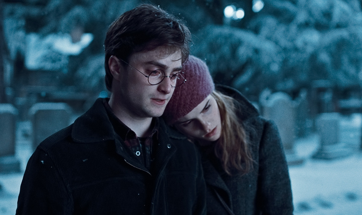 Harry and Hermione visit the grave of James and Lilly Potter