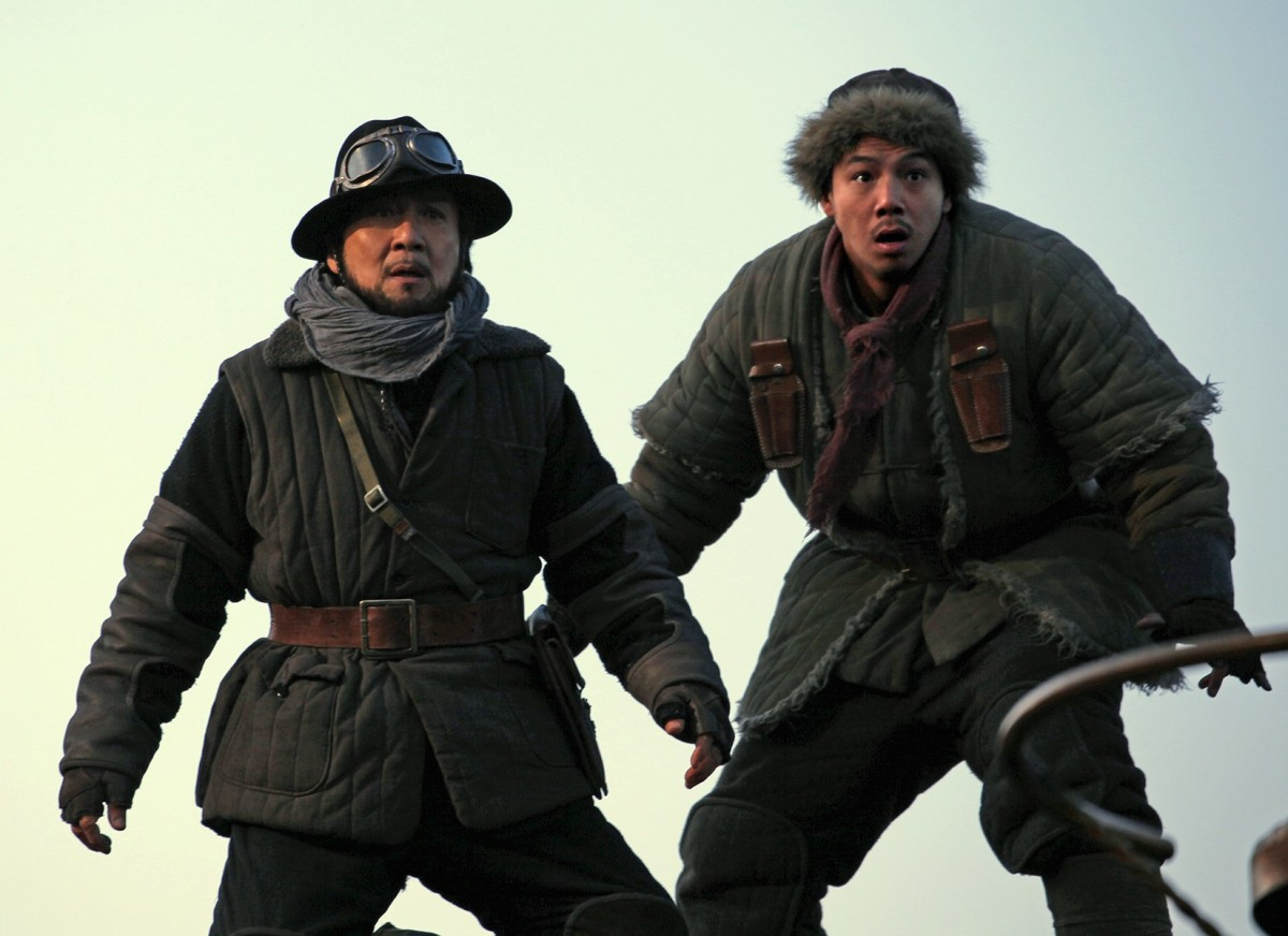 "Jackie Chan and Alan Ng in ""Railroad Tigers."""