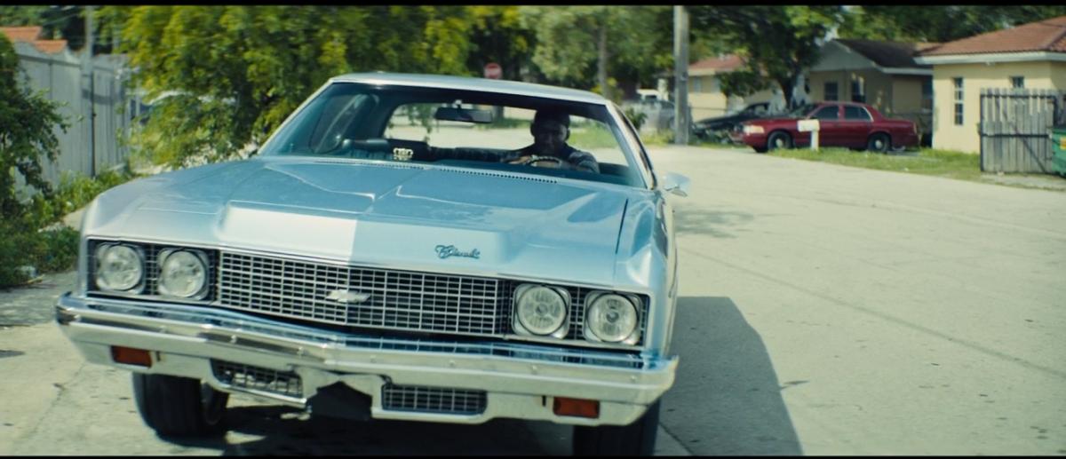 He drives a blue car.