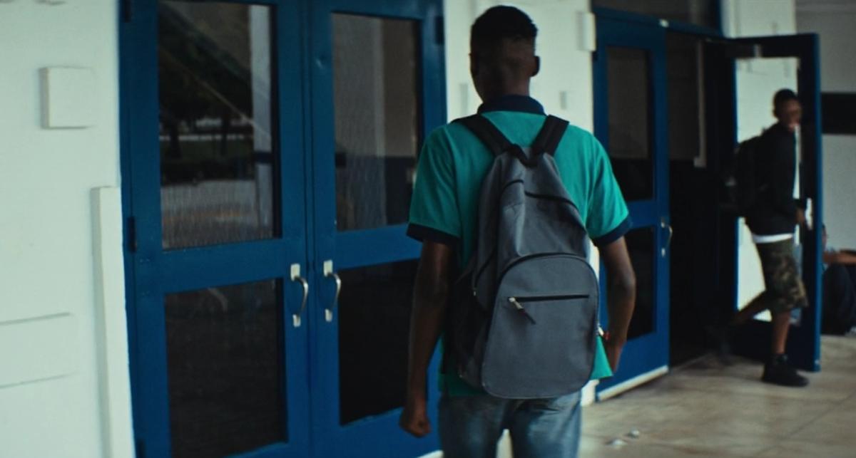 Blue doors, blue shirt.