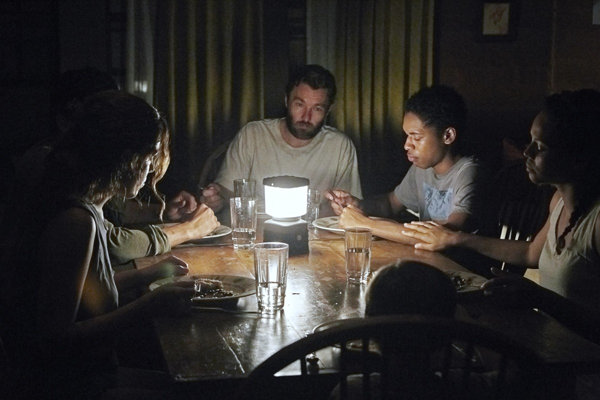 "Riley Keough, Christopher Abbot, Joel Edgerton, Kelvin Harrison Jr, and Carmen Ejogo in ""It Comes at Night."""