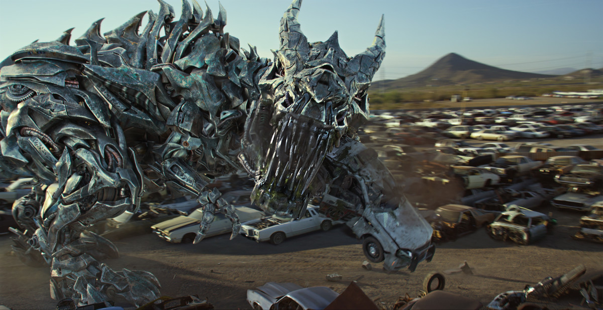 "One of the most pointless cameos in ""Transformers: The Last Knight"" next to John Turturro is Grimlock since all he does is eat a police car and a Decepticon no one cares about."