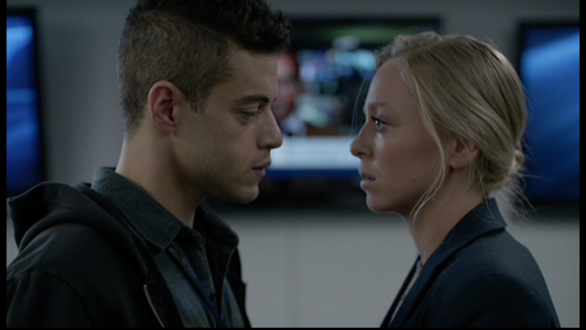 Elliot and Angela having a moment at work. Image copyright of USA Network.