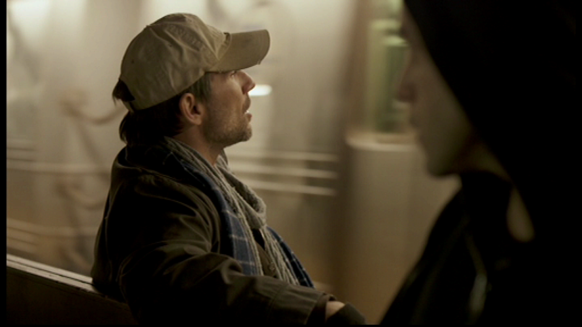 Elliot and the mysterious man on the train have a conversation on the train terminal. Image copyright of USA Network.