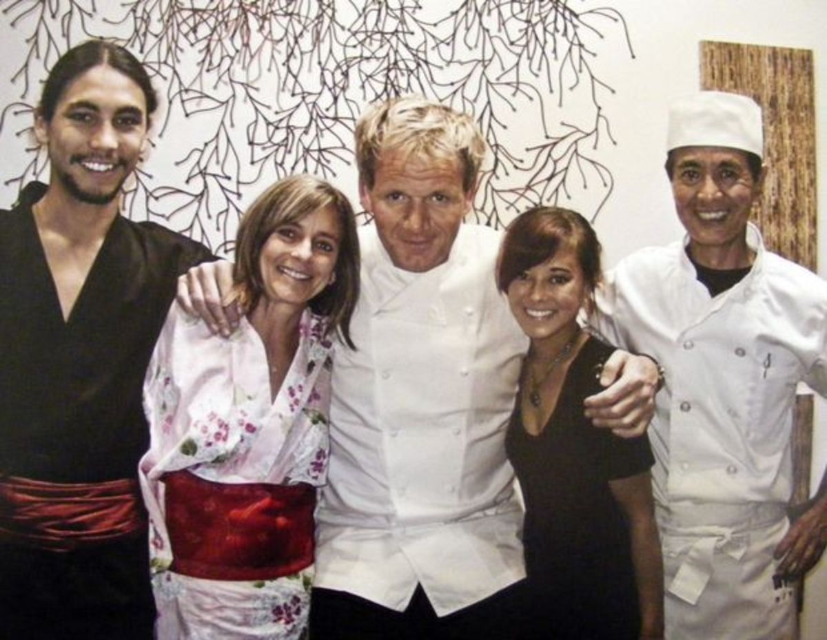 Gordon Ramsay poses with the family that owns Sushi Ko.