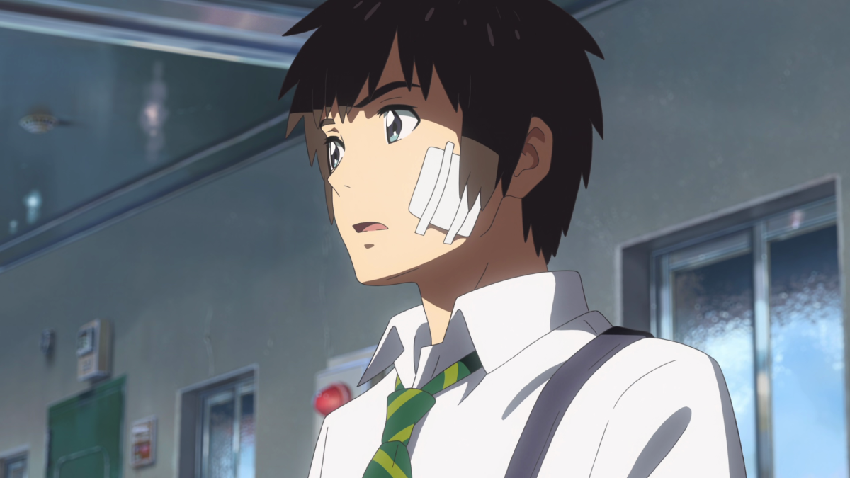 Mitsuha, now in Taki's body, leaves the apartment and gazes at the Tokyo skyline.