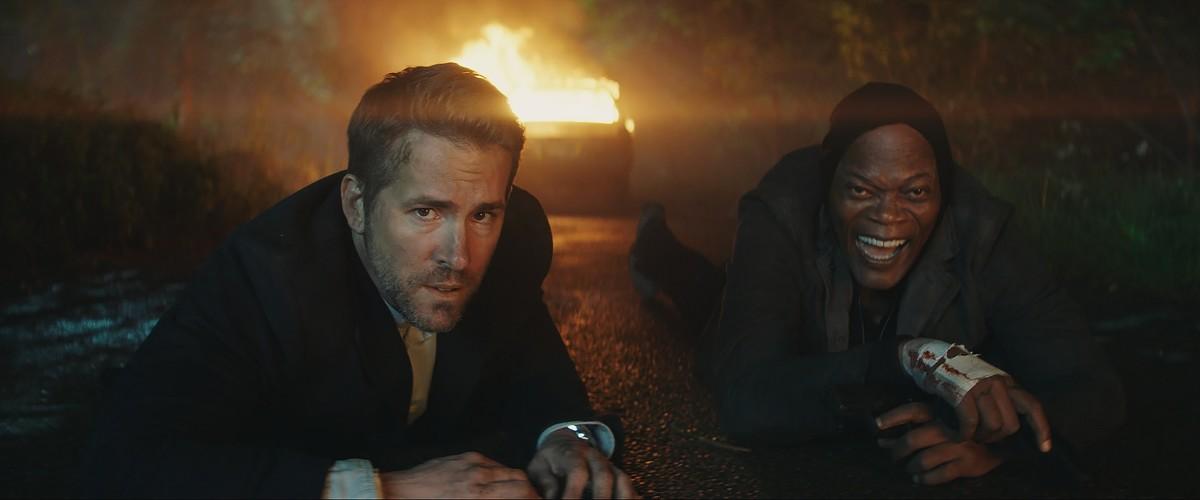 "Ryan Reynolds and Samuel L. Jackson as Michael Bryce and Darius Kincaid in ""The Hitman's Bodyguard."""