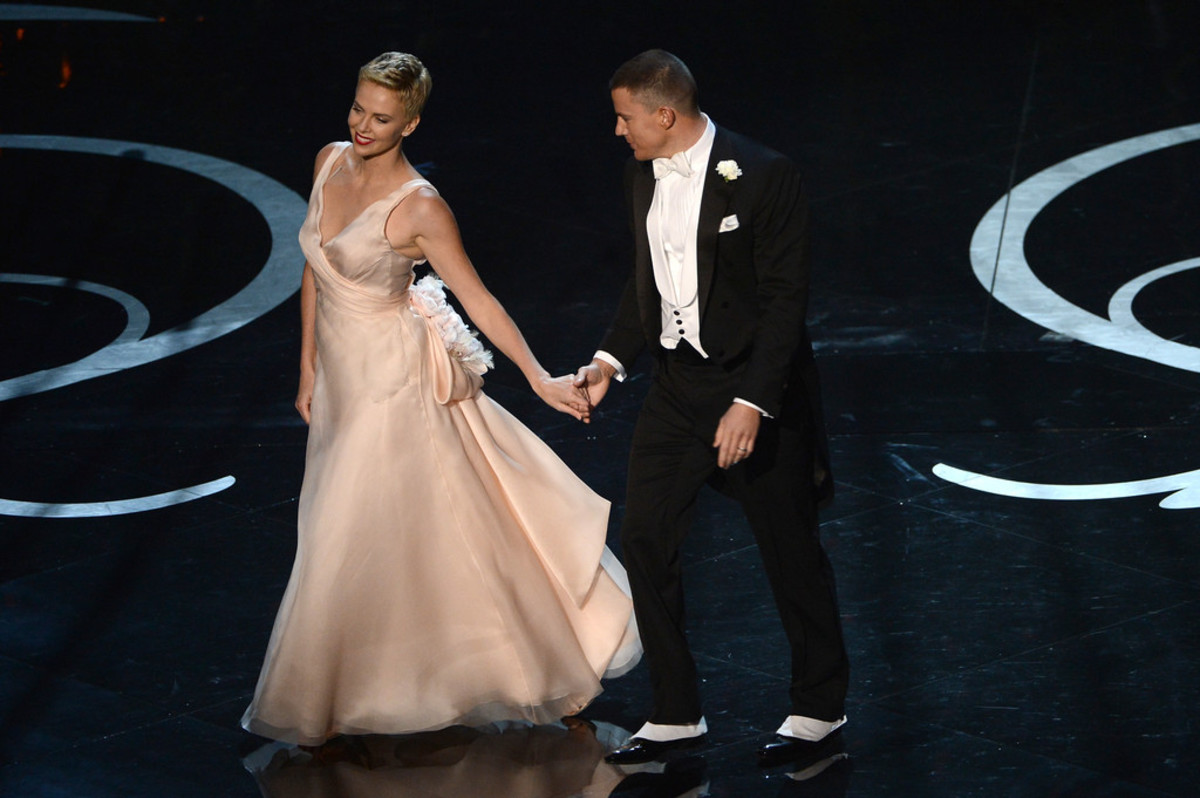 "Charlize Theron dances with Channing Tatum at the 2013 Oscars, held at the Dolby Theater in Hollywood, California.  Theron won the Oscar for ""Best Actress"" in 2004 for her portrayal of a female serial killer in ""Monster."""