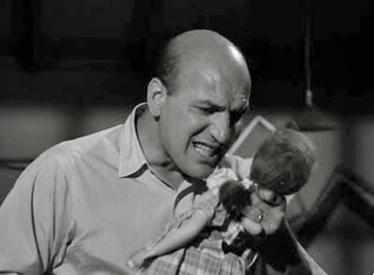 "Telly Savalas in ""Living Doll."""