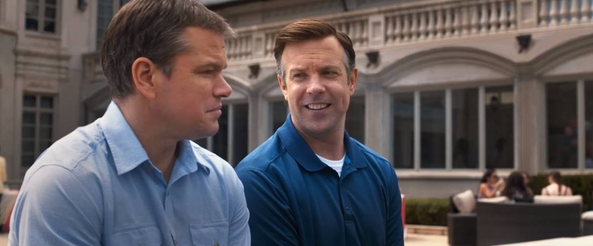"Paul Safranek (Matt Damon) and Dave Johnson (Jason Sudeikis) talk about the benefit of shrinking your entire life in ""Downsizing."""