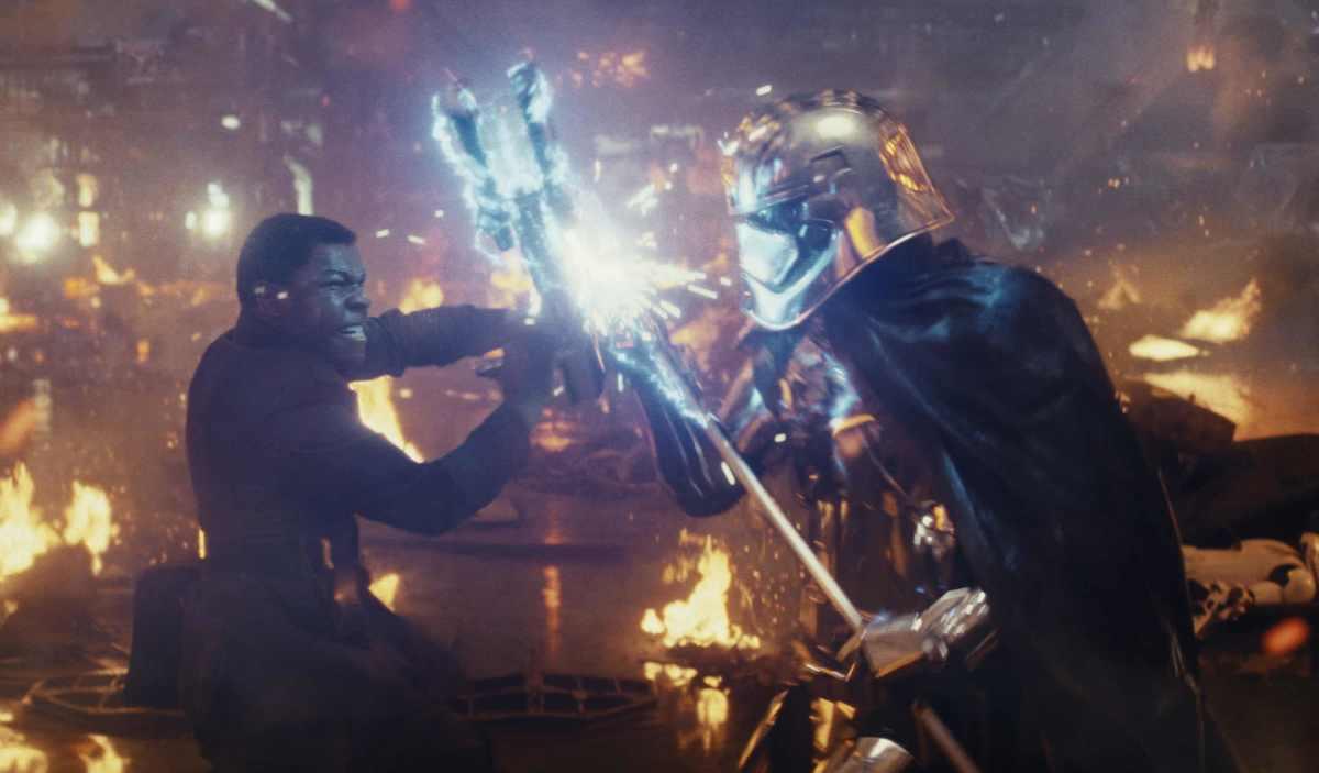 Finn (John Boyega) battles Captain Phasma (Gwendoline Christie).