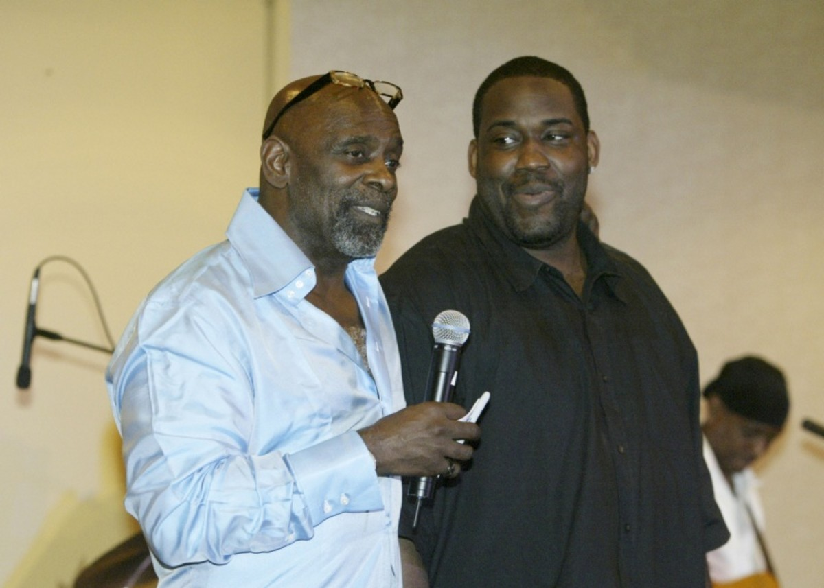 Chris Gardner and grown son at speaking engagement