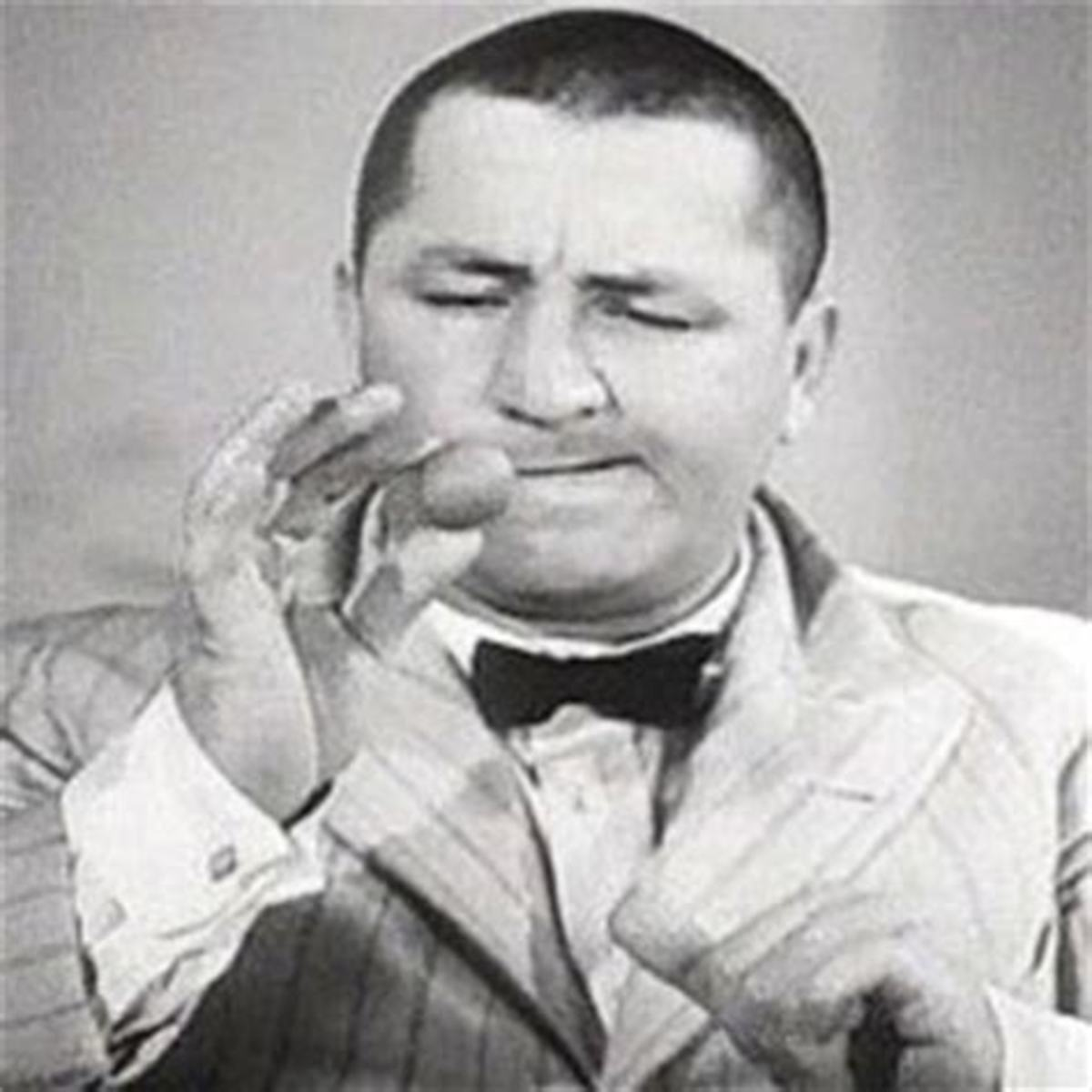 Curly Howard performing