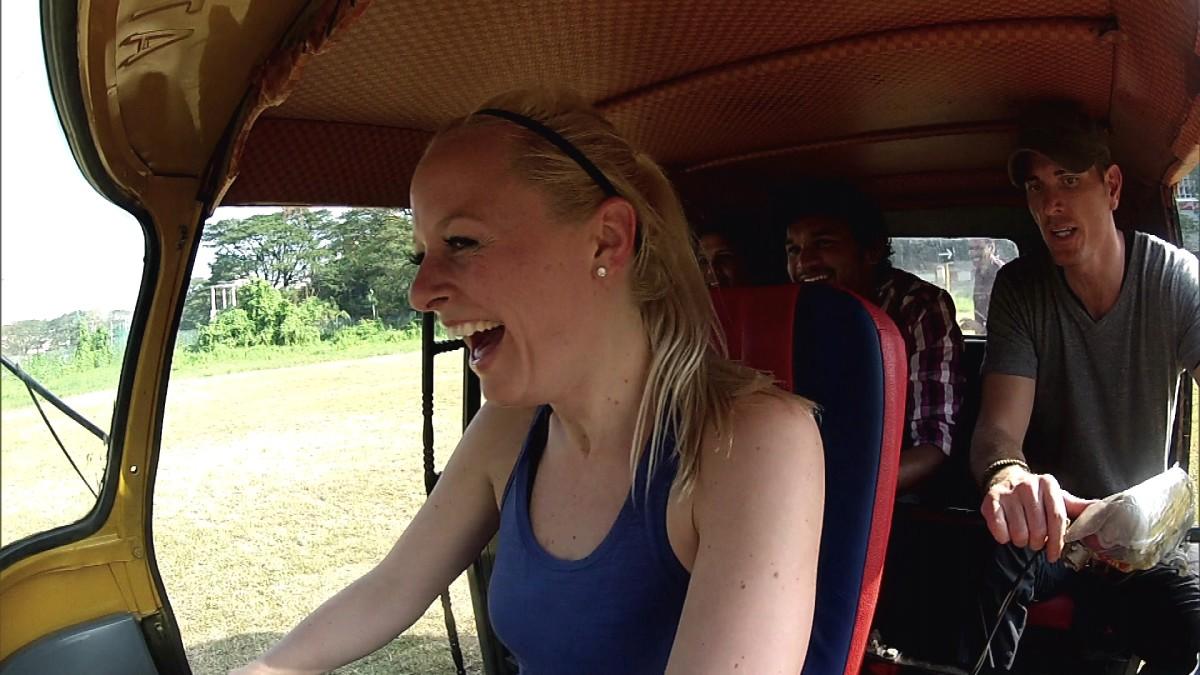 Rachel driving the rickshaw.