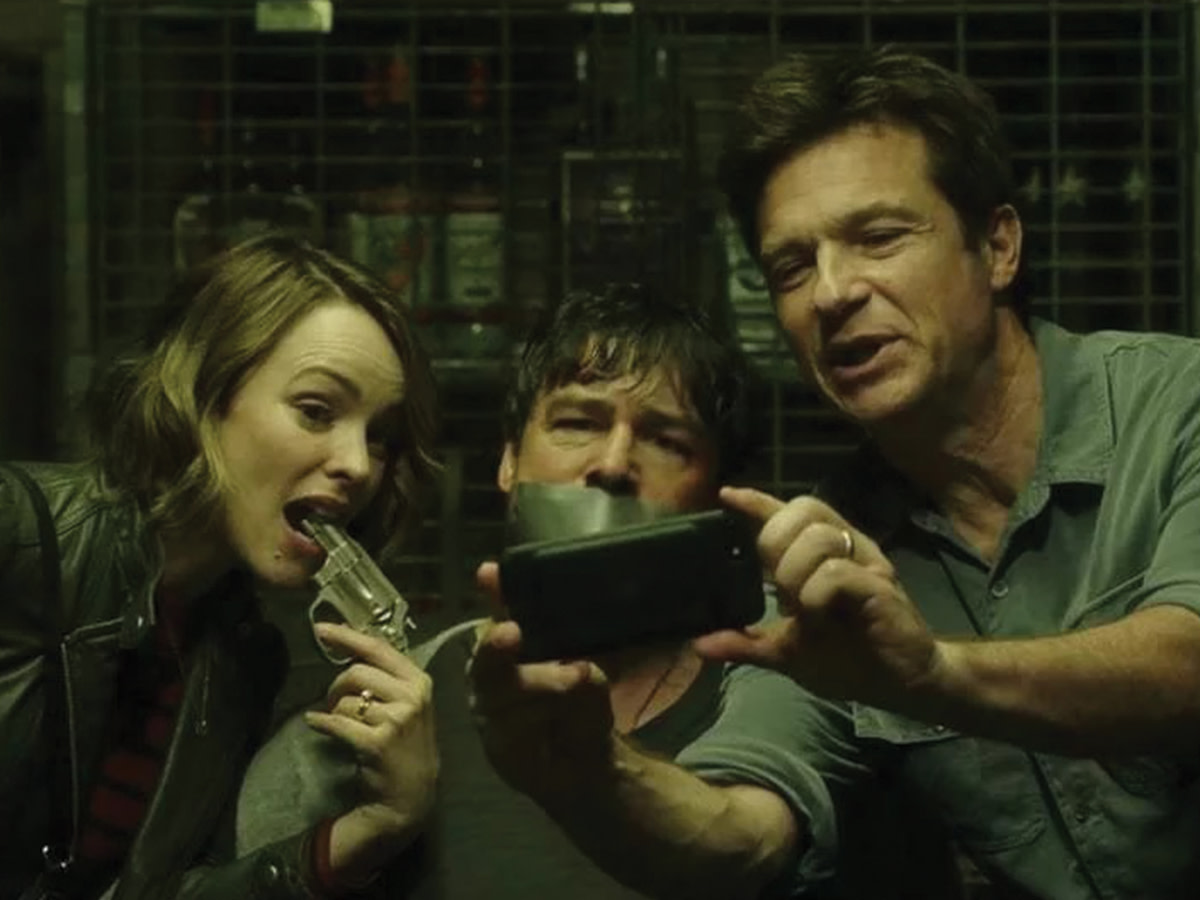 Kyle Chandler (middle) plays Brooks, Max's (Bateman) older and more successful brother