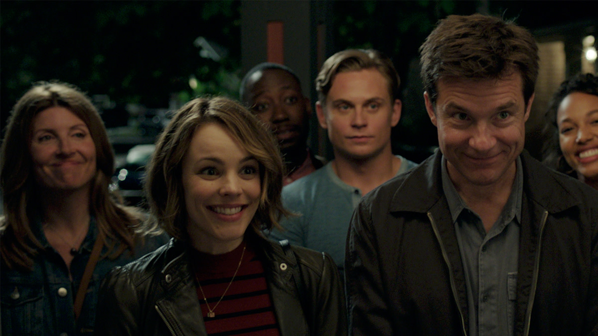 The Main Cast of Game Night (from left: Sharon Horgan, Rachel McAdams, Lamorne Morris, Billy Magnussen, Jason Bateman, and Kylie Bunbury