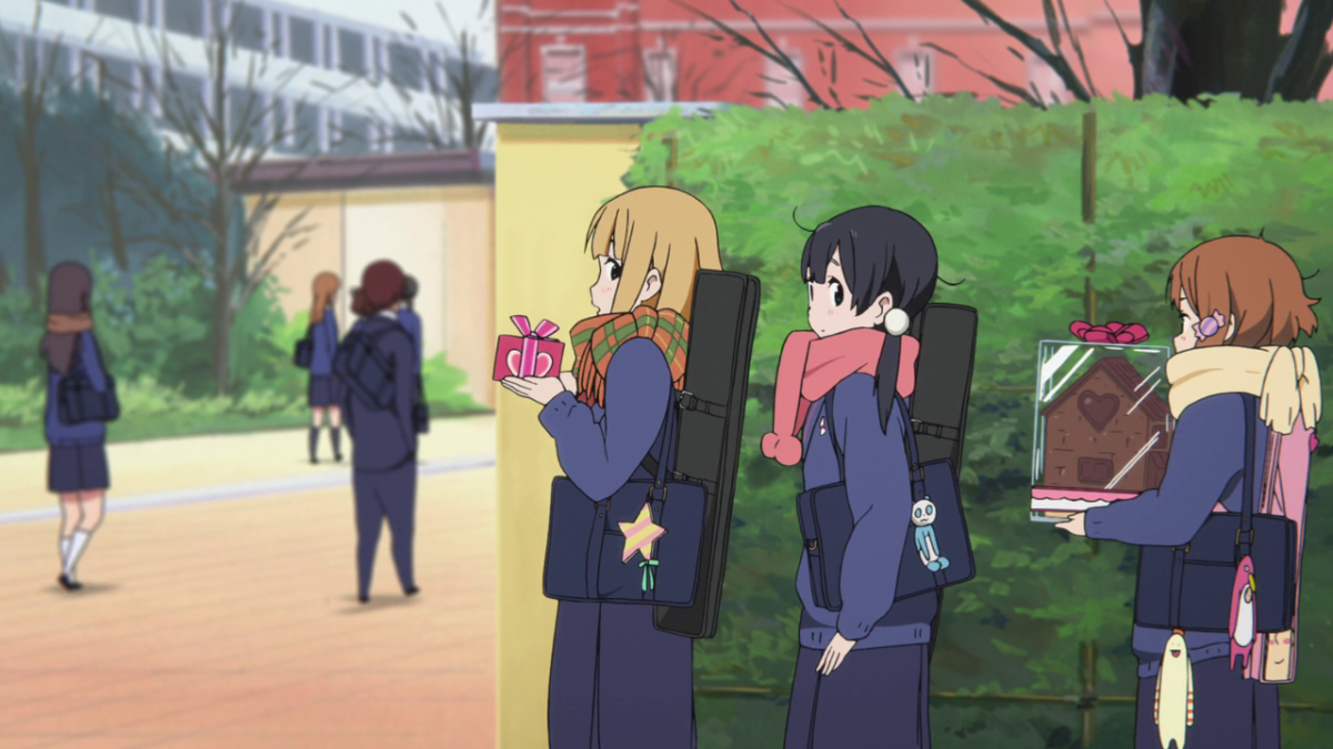 Tamako, at the school gates on Valentine's Day with her friends, Midori and Kanna.