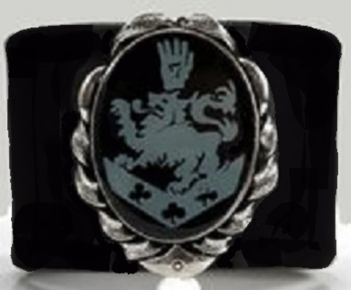 Edward is seen wearing the Cullen family crest on his wristband in the movie. The Cullen's are a coven of vampires, but there is no mention of a family symbol in the book.