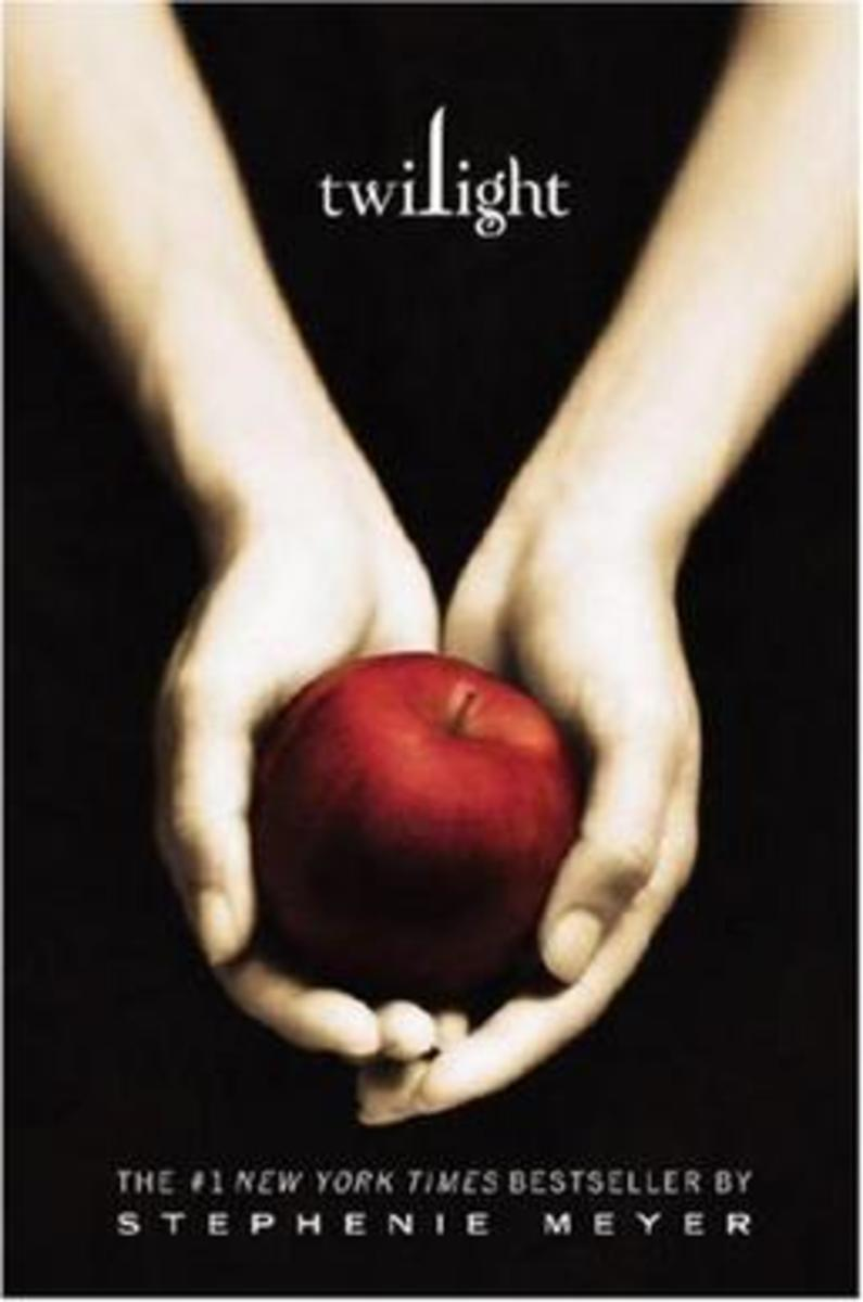The Twilight book cover is an image of pale hands holding up an apple. Coincidentally Edward catches Bella's apple in the movie.