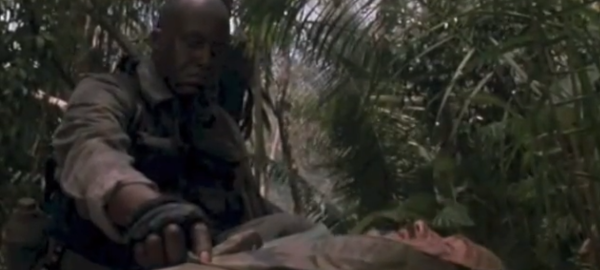 Courtesy of 20th Century Fox.  In Predator, when the character, Blain is killed, his friend, Mac spends the rest of the movie mourning him.  While he never cries, the fact that they were like brothers is clearly shown.