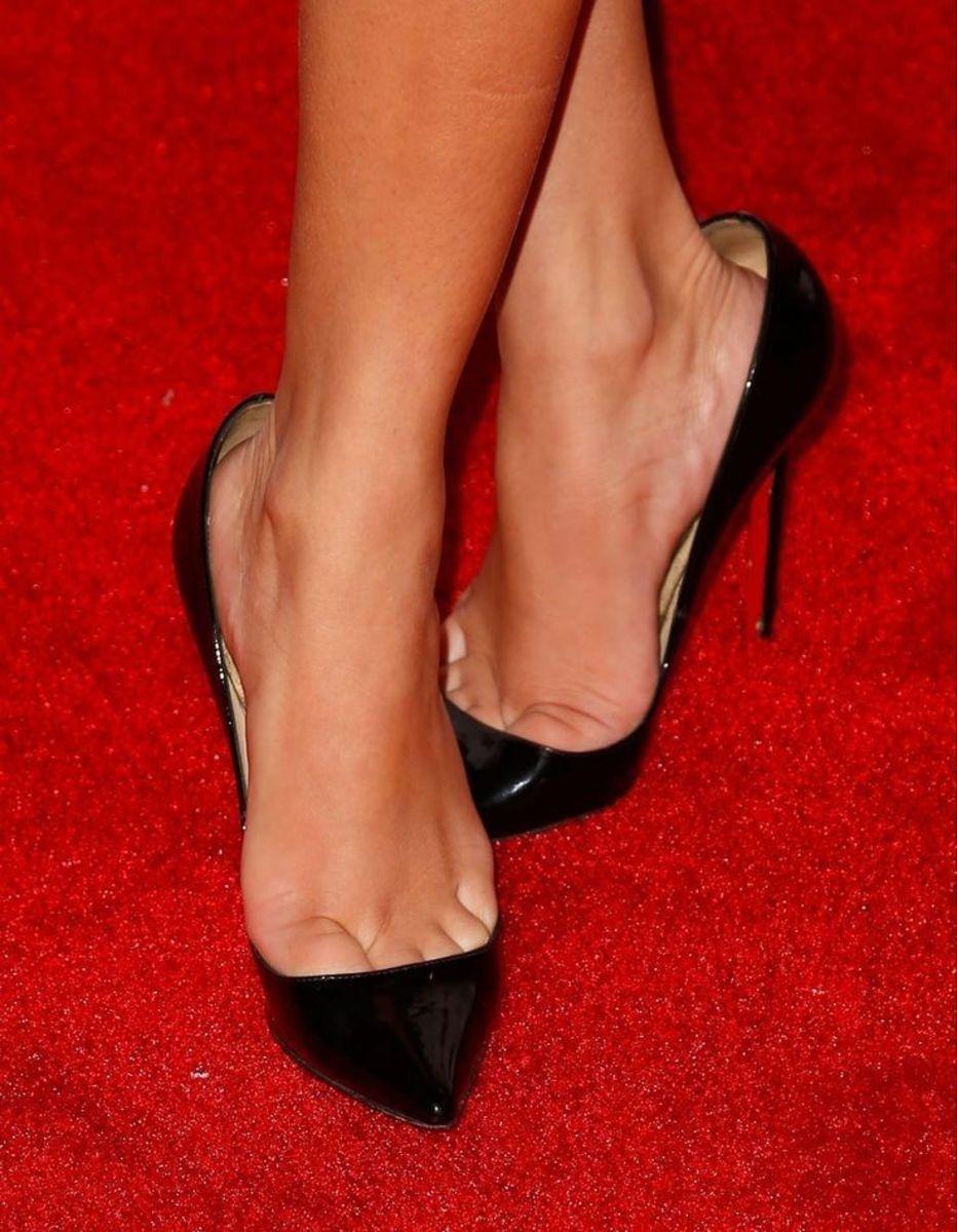 Adrienne Houghton wearing black patent high heel pumps