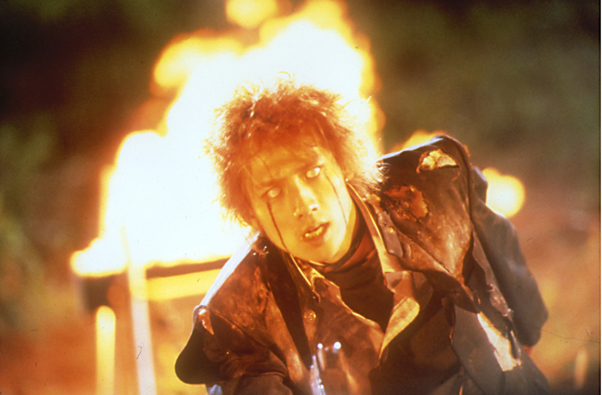Flames within mise-en-scene and make up used to transform Kazuo into a demon.