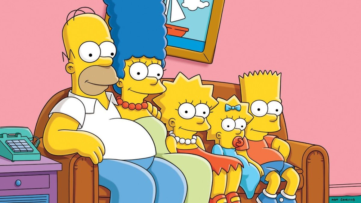 The Simpsons family sitting on their iconic couch.
