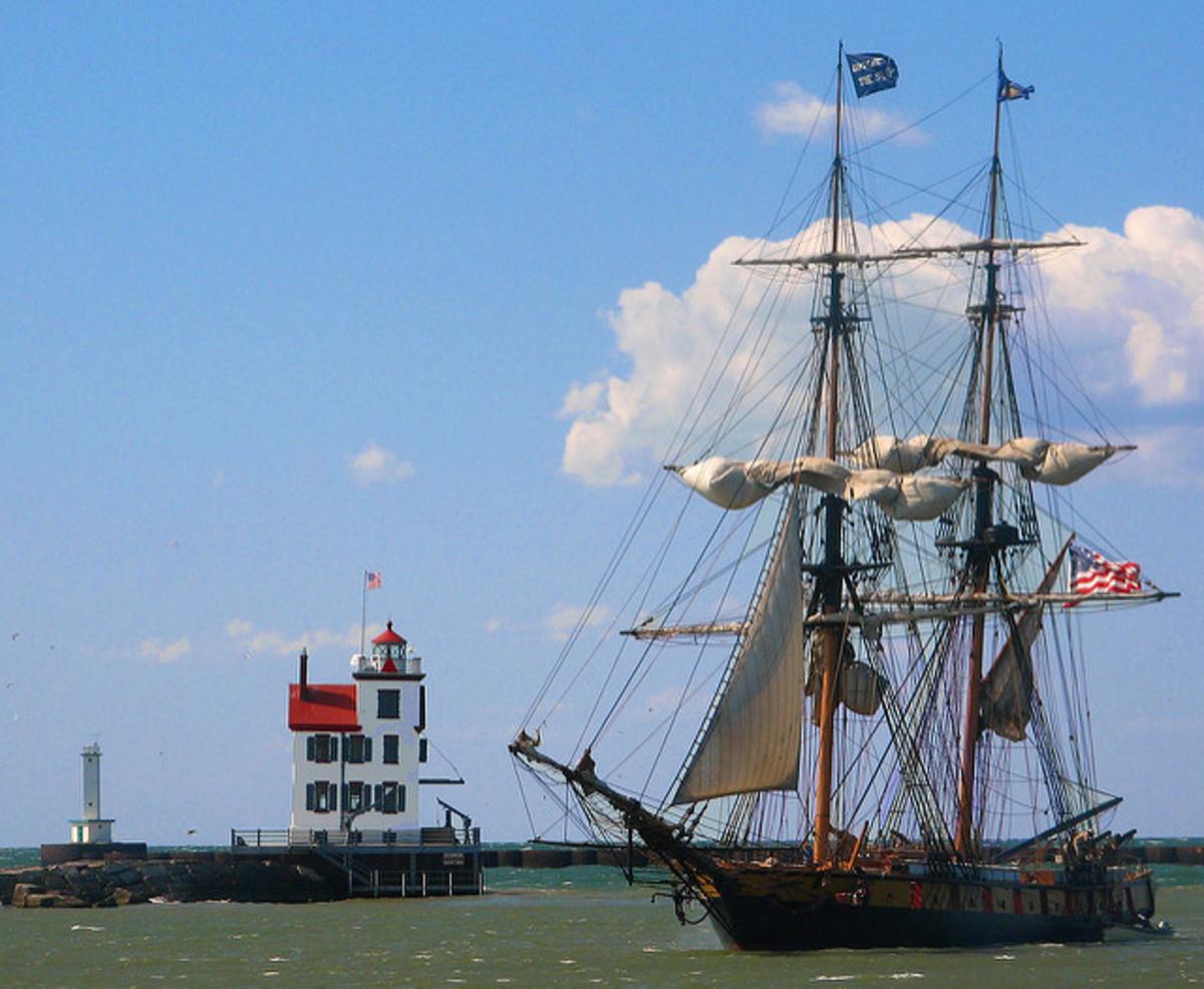Tall ship Niagara passes the Lorain lighthouse