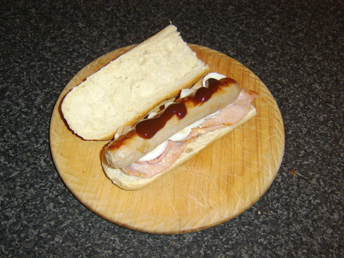 A hearty sausage, bacon and egg sandwich with optional HP Sauce - the perfect early morning munch when sea fishing