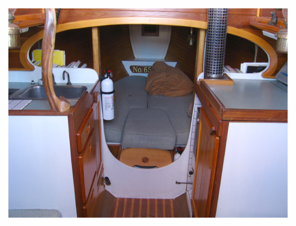 The cramped quarters down below do contain quiet a few amenities, including galley, v-berth, and a head (next to a cut-away v-berth in most models)