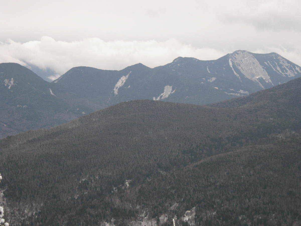 Snow clouds form over the Upper Range as seen from a lookout near the summit of Porter.