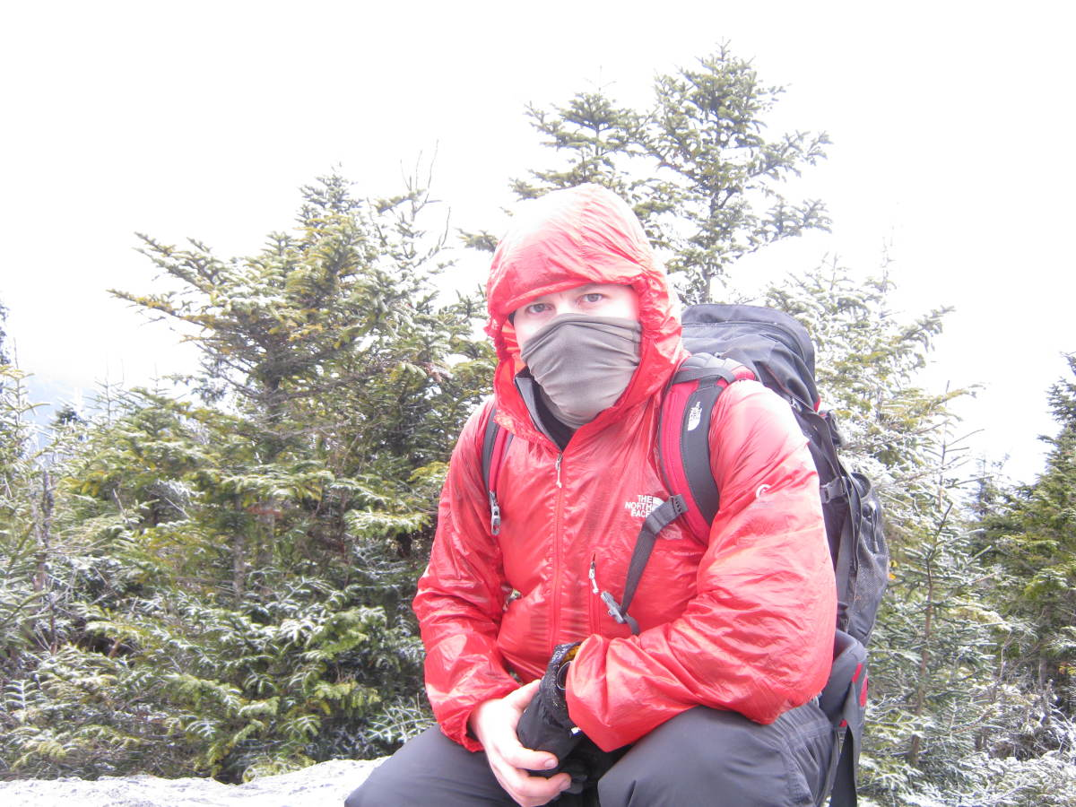 A good set of lightweight waterproof/windproof/breathable shells are paramount for hiking the High Peaks in all seasons.  Here I am on the summit of Porter.