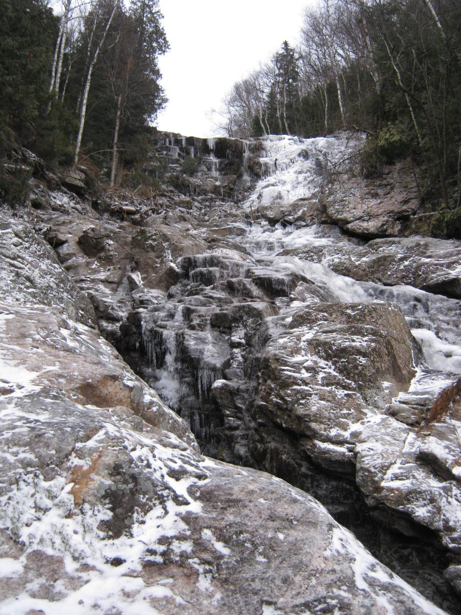 Beyond the waterfall, the slide grows steep with great crevices punctuating the landscape.
